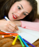 Girl writing a letter. A girl writing a letter on the paper royalty free stock photography
