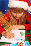 Girl writing a letter to santa Stock Photos