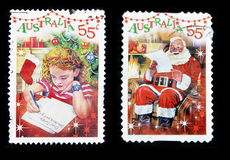 Girl writing letter to Santa Claus and Santa Claus Stock Photography