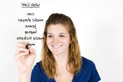 Girl writing list Stock Photos