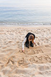 Girl Writing New Year in Sand Stock Photos