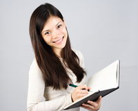 Girl writing in notebook Stock Photography
