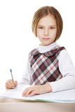 Girl writing in notebook homework Stock Photography