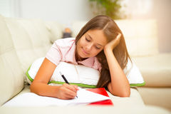 Girl writing in a notebook Stock Photography