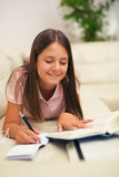 Girl writing in a notebook Royalty Free Stock Images