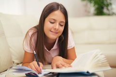 Girl writing in a notebook Royalty Free Stock Photography