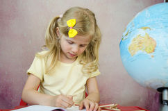 Girl writing into notepad Stock Images