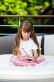 Girl writing at notepad Royalty Free Stock Photos
