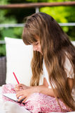 Girl writing notes Stock Photos