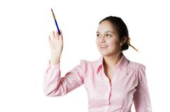 Girl is writing with brush. Girl is writing with paintbrush. Frontview. Isolated royalty free stock photos