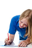 Girl writing on paper Stock Photo