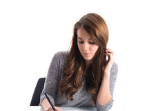 Girl writing on paper Royalty Free Stock Photography