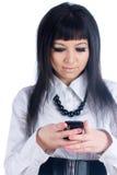 Girl writing sms Royalty Free Stock Image