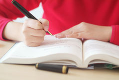 Girl  writing  for study Royalty Free Stock Photos