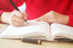 Girl  writing  for study Royalty Free Stock Image