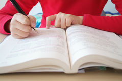 Girl  writing  for study Royalty Free Stock Images