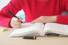 Girl  writing  for study Stock Photo