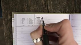 Girl writing three exclamation marks near the word Monday. stock footage