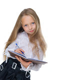 Girl writing on white. Beaty girl writing in dairy isolated on white Stock Photo