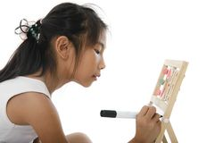 Girl writing on white board isolated on white. stock image
