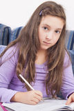 Girl writting homework Royalty Free Stock Photography