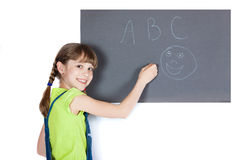 Girl wrote in chalk on gray board. Royalty Free Stock Photography