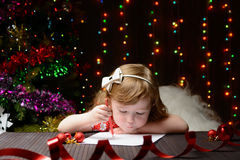 Girl wrote in red pencil a letter to Santa Claus Stock Photos