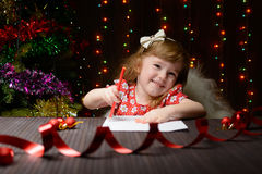 Girl wrote in red pencil a letter to Santa Claus Royalty Free Stock Photo