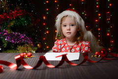 Girl wrote in red pencil a letter to Santa Claus Royalty Free Stock Images