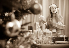 Girl with X-mas presents at home Royalty Free Stock Images