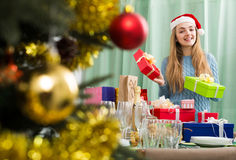 Girl with X-mas presents at home Royalty Free Stock Photography