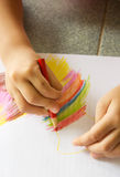 Girl& x27;s hand drawing a picture. Stock Photos