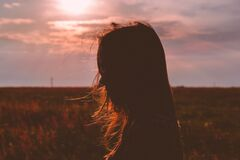 Girl's head silhouette at sunset Royalty Free Stock Images