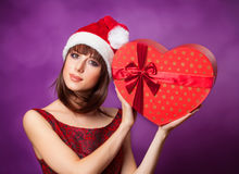 Girl in xmas hat with gift box Stock Photos