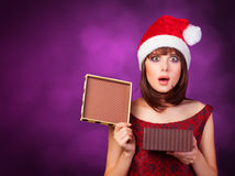 Girl in xmas hat with gift box Stock Images