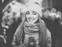 Girl at Xmas market. Pretty  girl in coat posing at Chrisrmas market  in evening Royalty Free Stock Photography