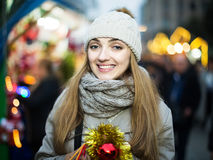 Girl at Xmas market. Pretty  girl in coat posing at Chrisrmas market  in evening Stock Photography