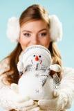 Girl with xmas snowman. Stock Photos