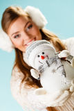 Girl with xmas snowman. Royalty Free Stock Photo
