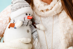 Girl with xmas snowman. Royalty Free Stock Photography