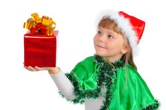 The girl in a Xmas suit with a gift Royalty Free Stock Image