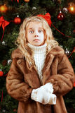 Girl and xmas tree Stock Images