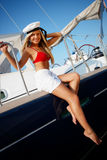 Girl on a yacht Stock Images