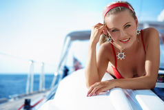 Girl on a yacht. Attractive girl sailing on a yacht on summer day stock images