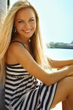Girl on a yacht. Attractive girl sailing on a yacht on summer day Royalty Free Stock Photography