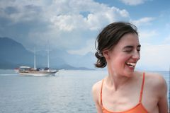 Girl and yacht Stock Image