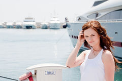 A girl and a yacht Stock Photo