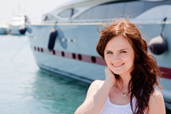A girl and a yacht Stock Image