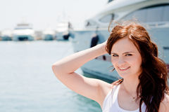 A girl and a yacht Royalty Free Stock Photo
