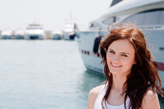 A girl and a yacht Royalty Free Stock Image